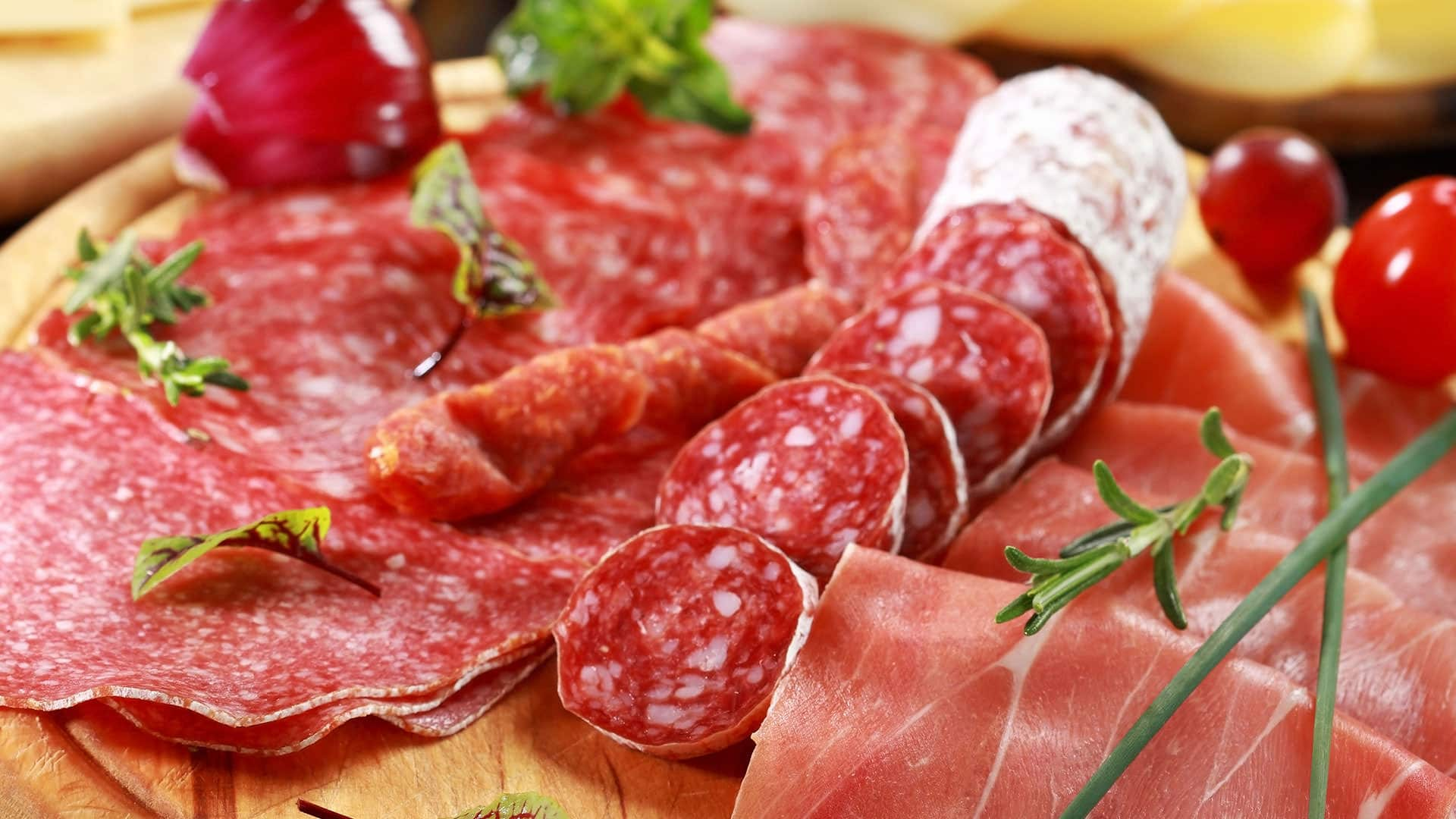 Sliced salami on cutting board